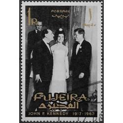 34.- J.F.Kennedy s manželkou ,o,